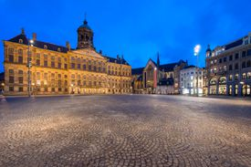 The Royal Palace at Dam square in Amsterdam on a bright night