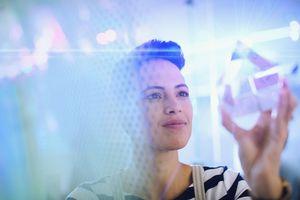 Woman examining crystal cube