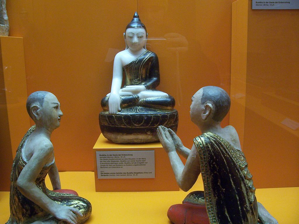 Statues of Buddha, Mogallana and Sariputta in a museum.