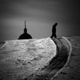 Man walking alone near a church