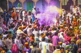 In a Temple Outdoor Part, of Mathura District, the Crowd Is Celebrating Holi Festival