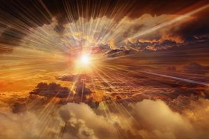 Sunbeams shining through clouds in dramatic sky