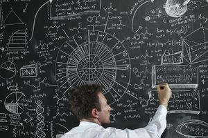 man at a chalk board