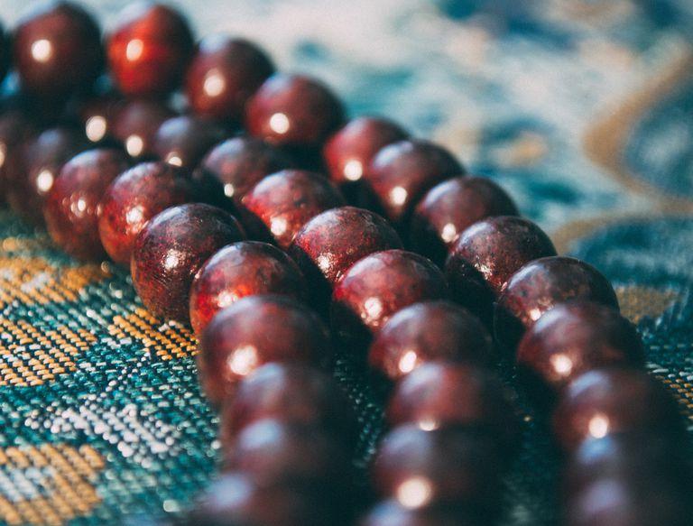 Islamic Prayer Beads on Prayer Mat