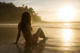 A woman enjoying the sunset