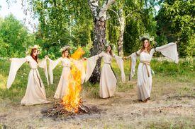 Women Dancing Around Bonfire
