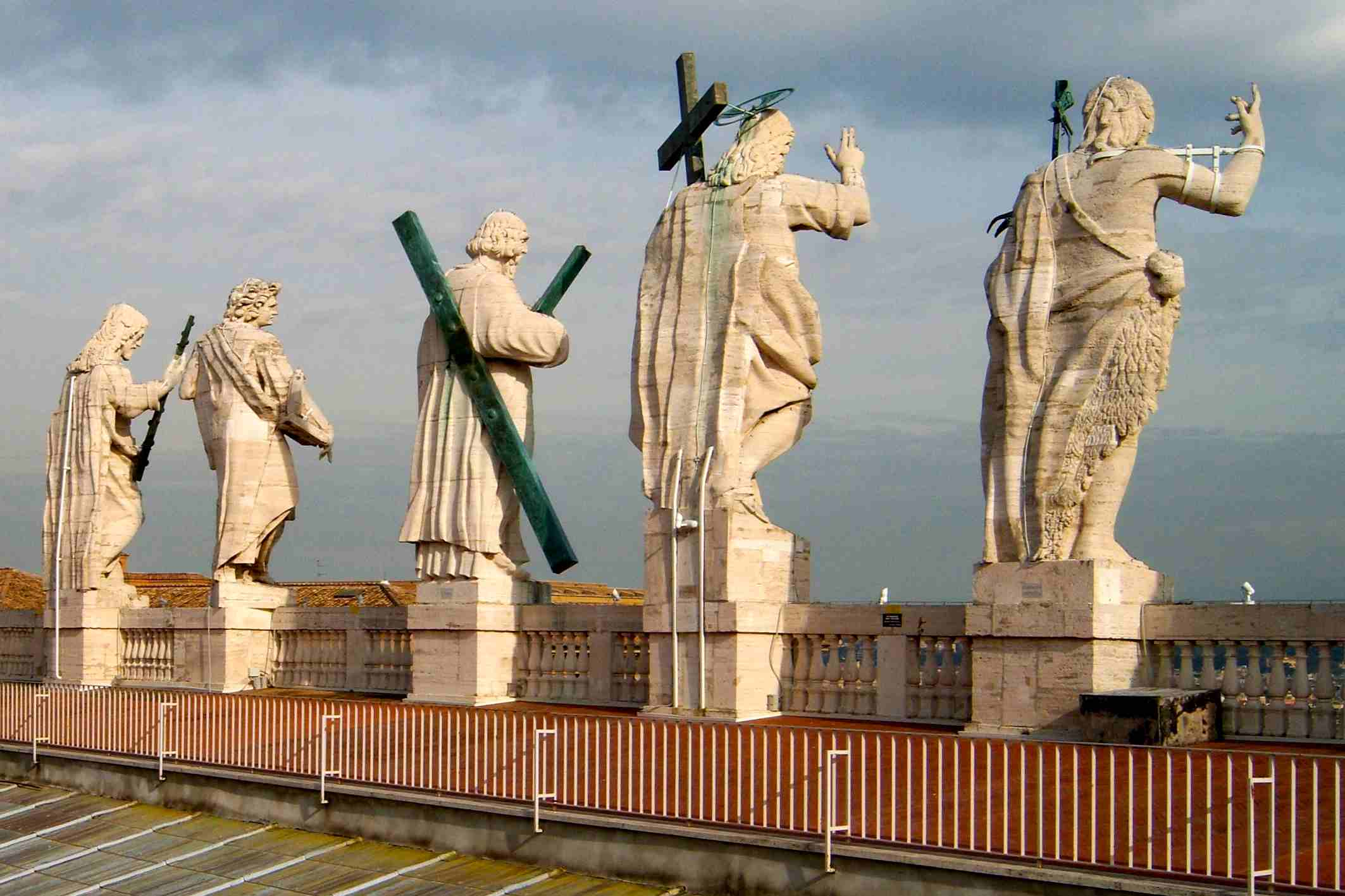 Statues of the Apostles, Jesus Christ, and John the Baptist on the façade of Saint Peter's Basilica,