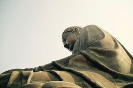 Low Angle View Of Buddha Statue Against Clear Sky