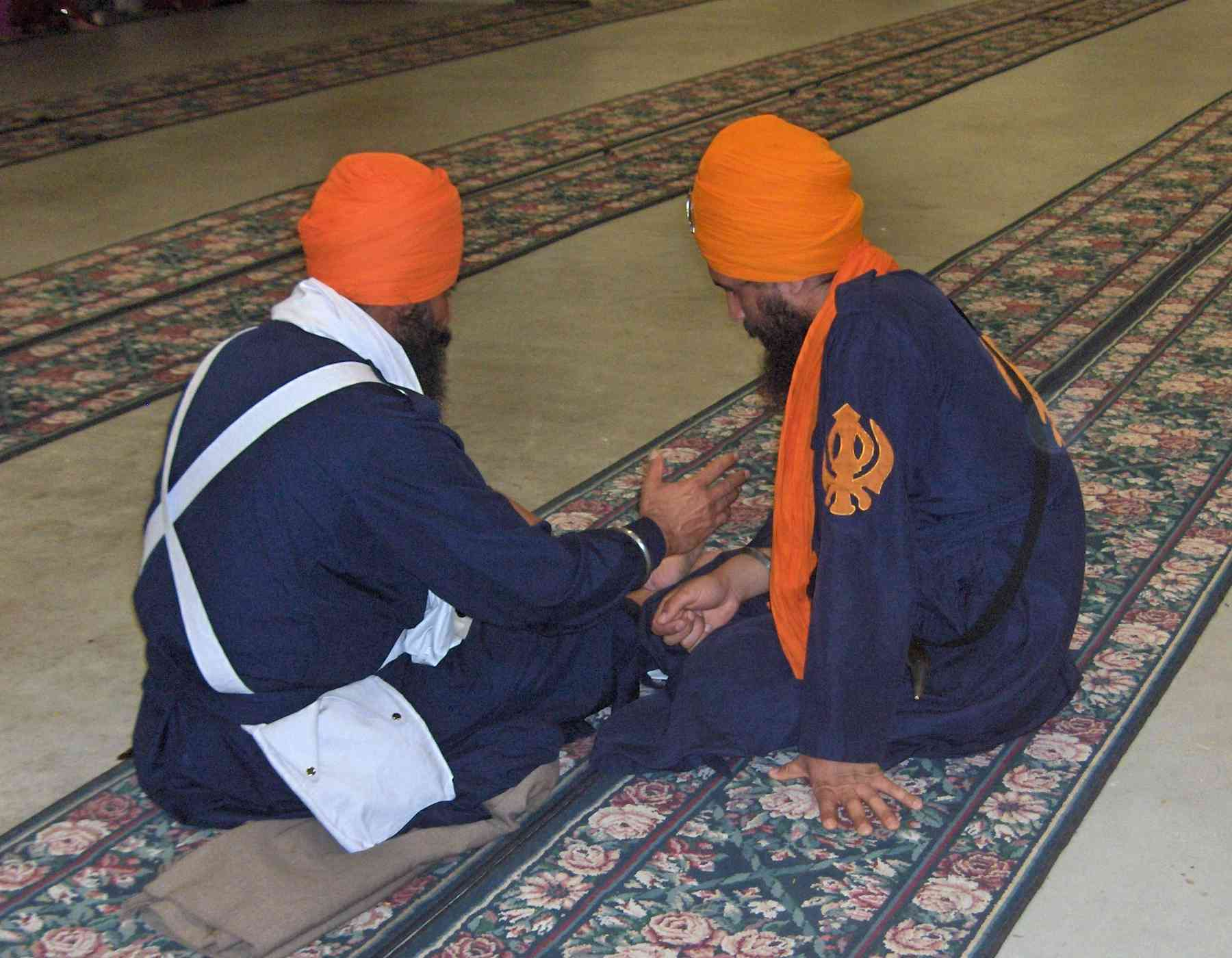 Orange Khanda Displayed on Blue Bana