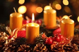 Advent wreath with one burning candle.