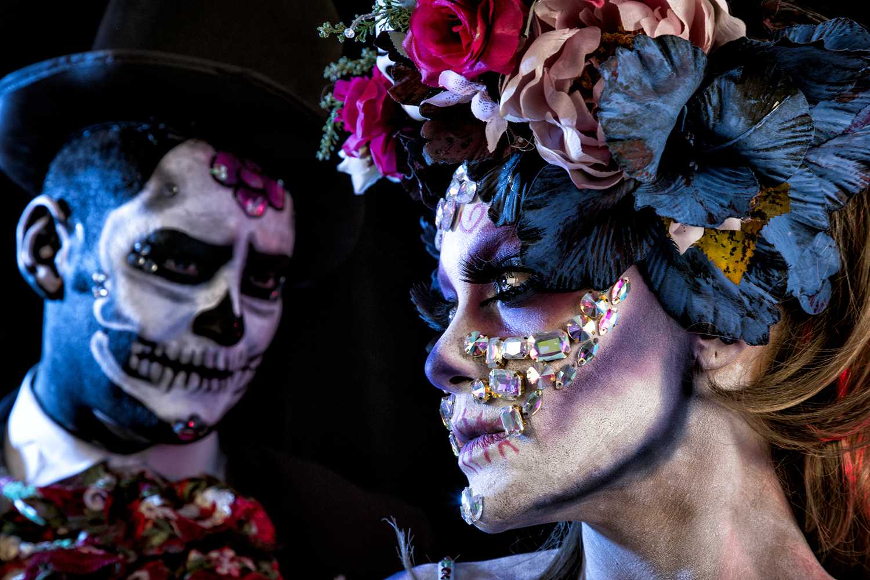 people celebrating Dia De Los Muertos