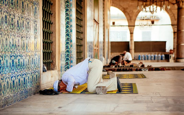 Man Offering Namaz At Mosque