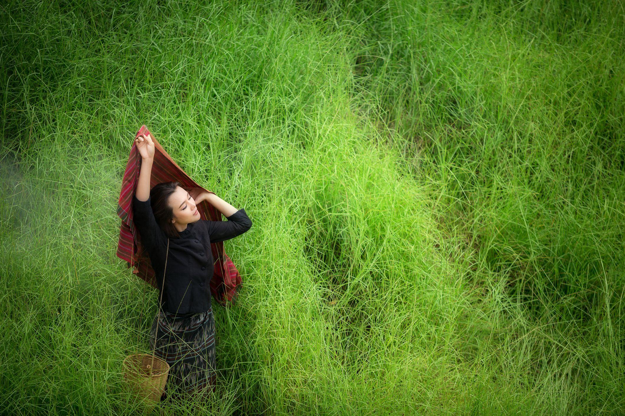 Woman in grassy field