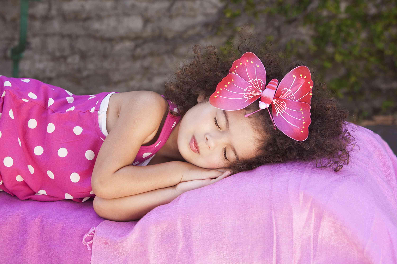 Little girl sleeping outside