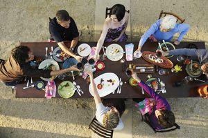 Arial shot of people cheers around a table