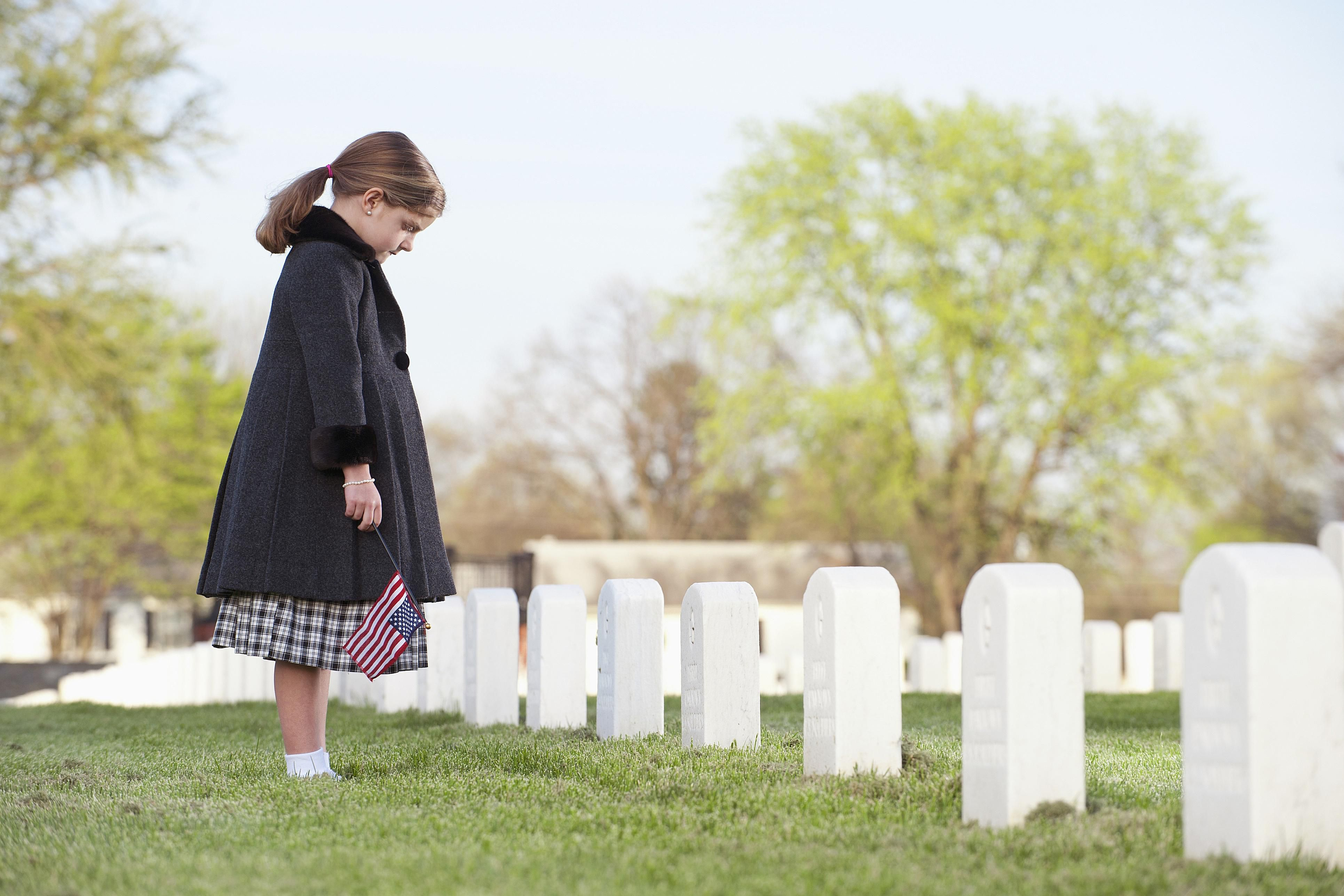 A girl in a cemetery.