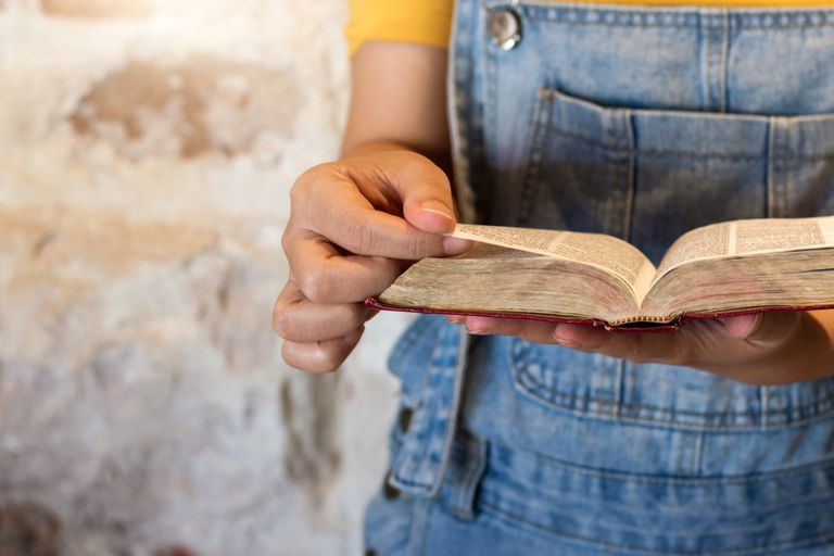 Humble person searching the Bible