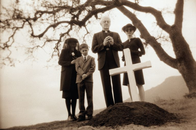 Priest and Family at Father's Grave