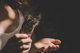 Woman Holding Burning Sage
