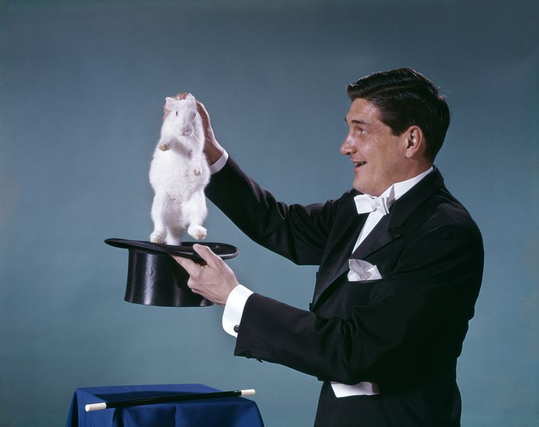 1960s Magician pulling rabbit out of a hat