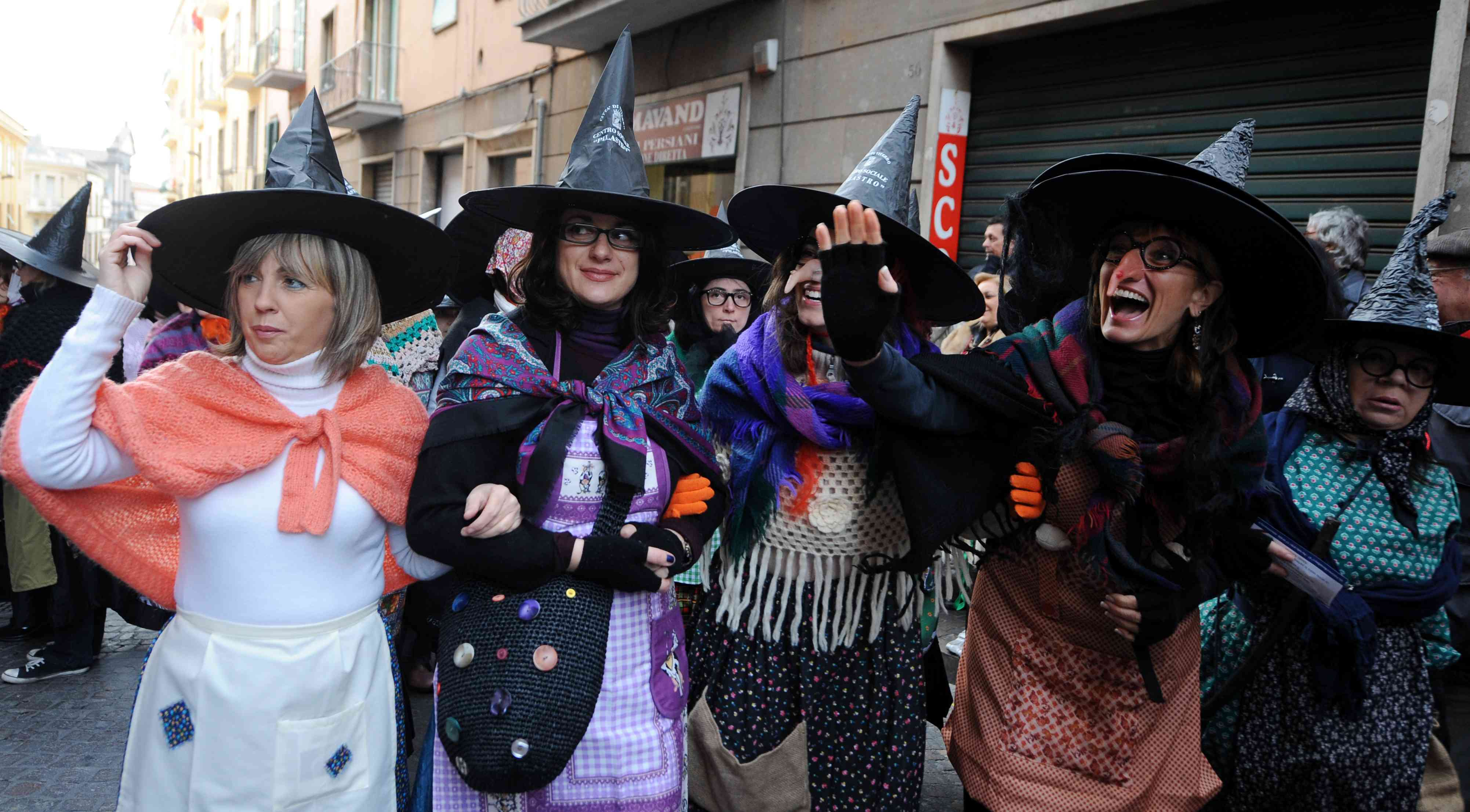 Women dressed as the witch Befana parade
