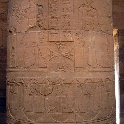 Coptic Cross on Ancient Monument with Ankhs and Was Symbols