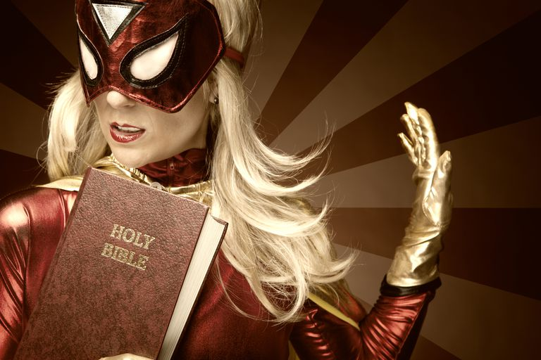 Female Superhero holding Bible.