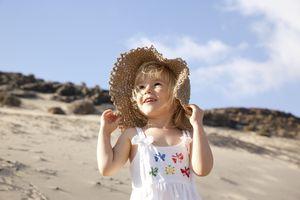 Spain, Fuerteventura, happy girl on the beach