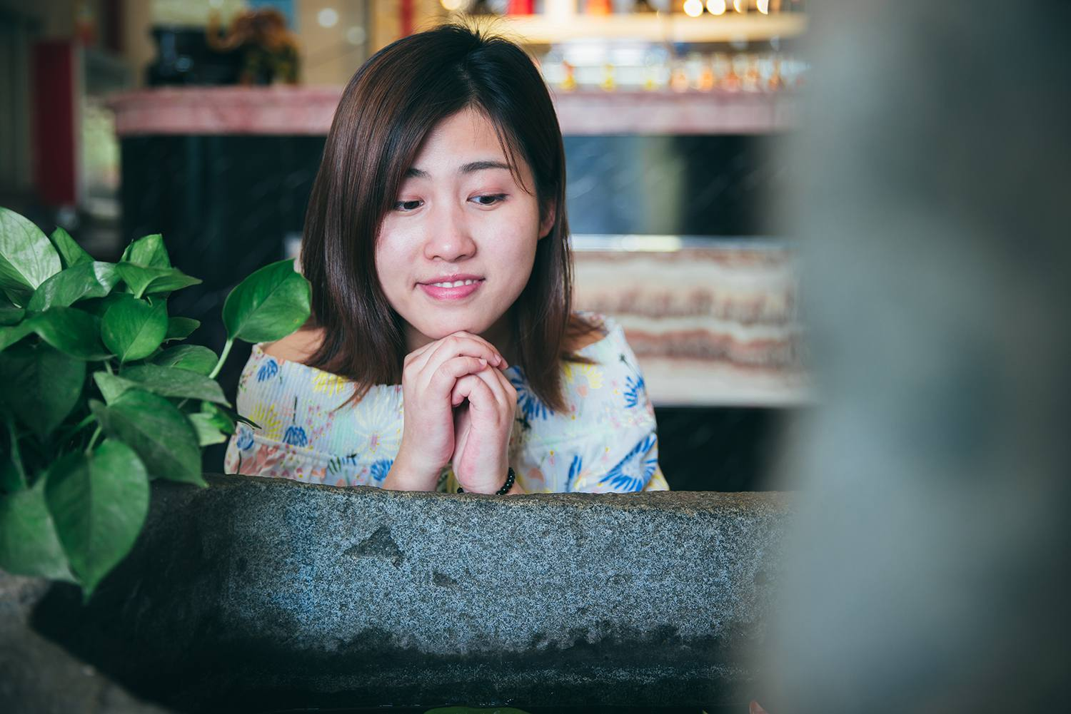 Close up of pretty girl in a prayer position before a goldfish bowl,Shanghai,China.