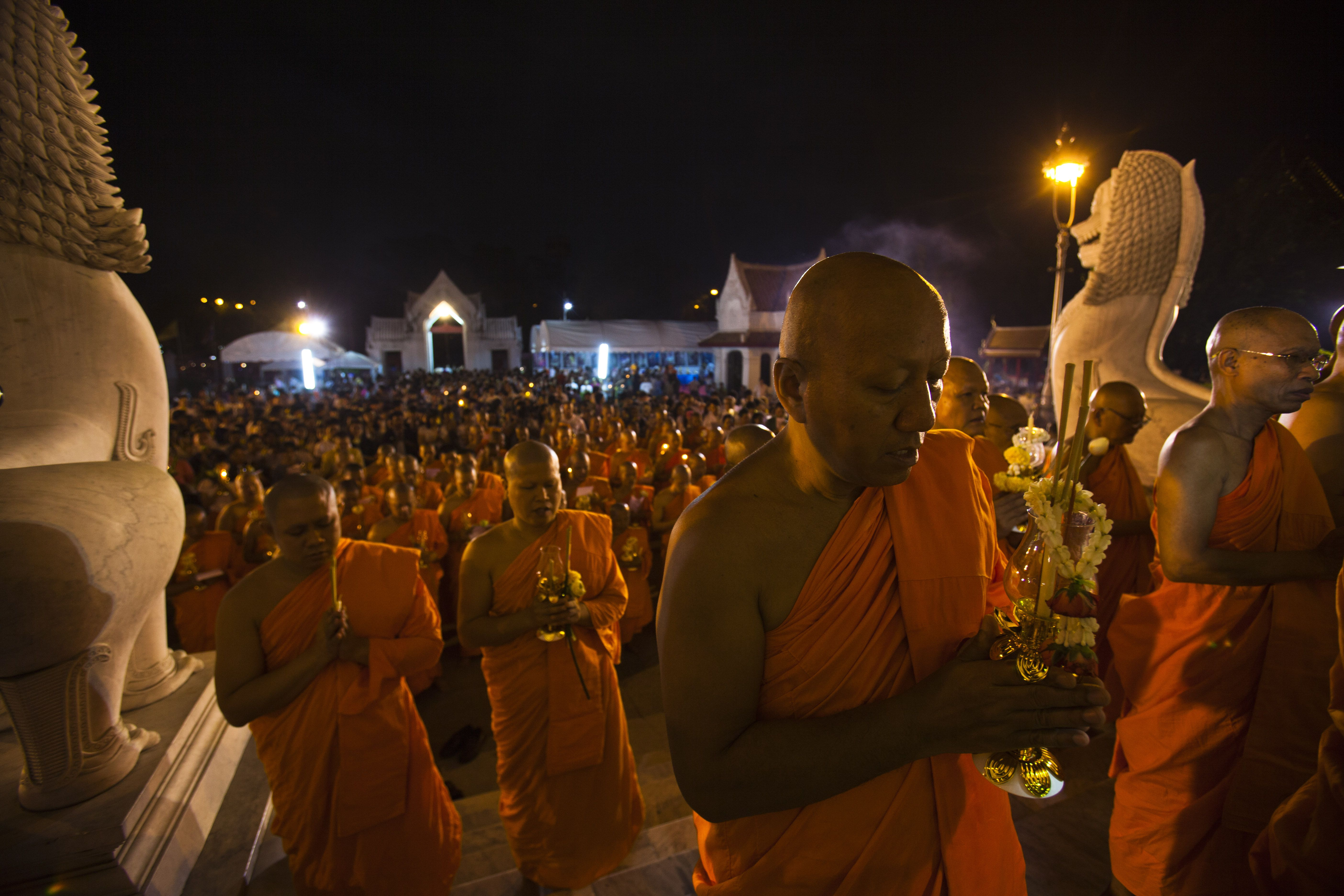 Thai Buddhist monks offer prayers celebrating Magha Puja day at Wat Benchamabophit (Marble Temple) in Bangkok.