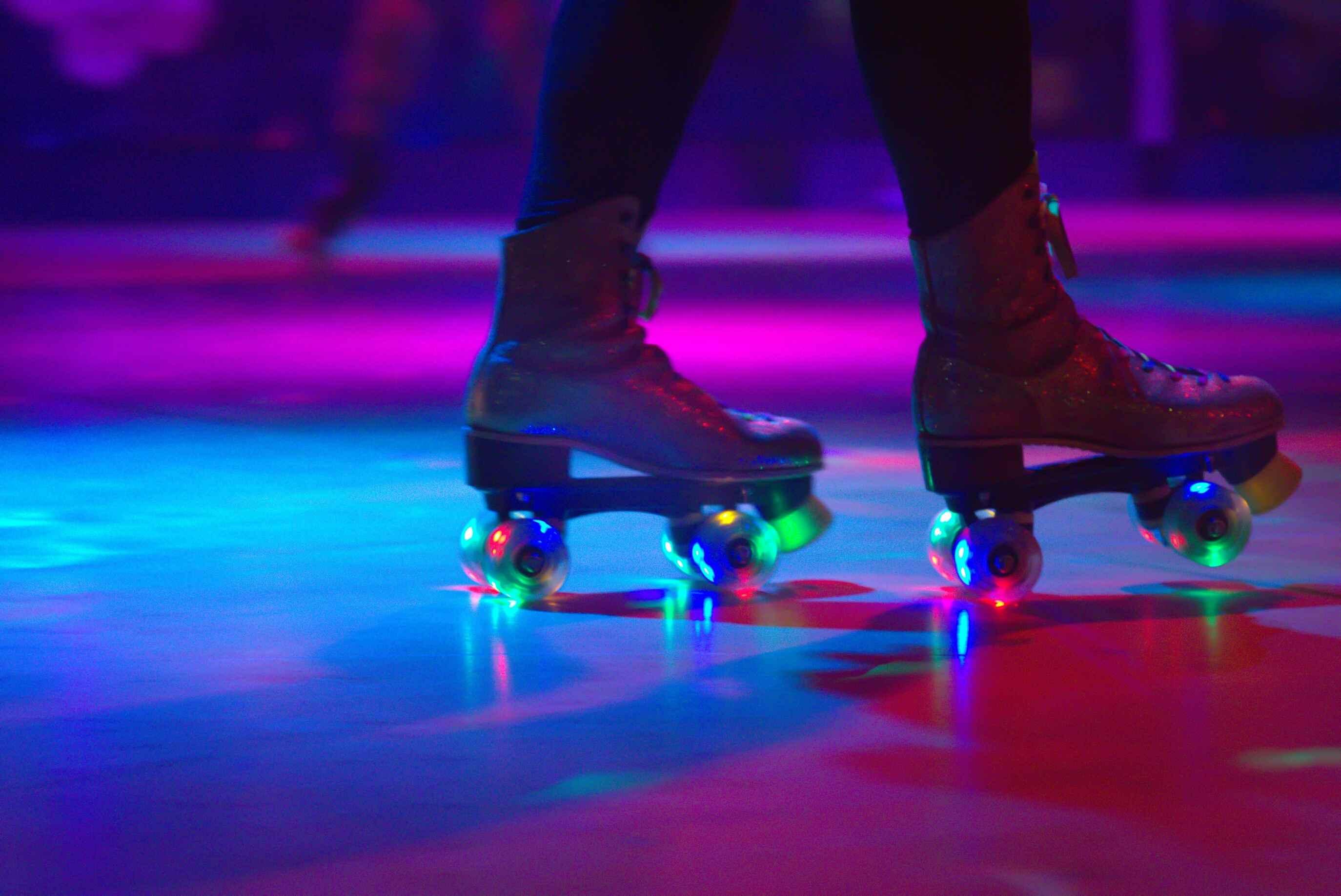 Person Roller Skating in Illuminated Rink
