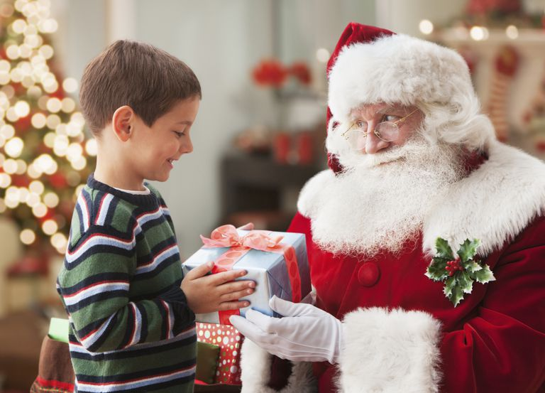 Santa giving Caucasian boy Christmas gift