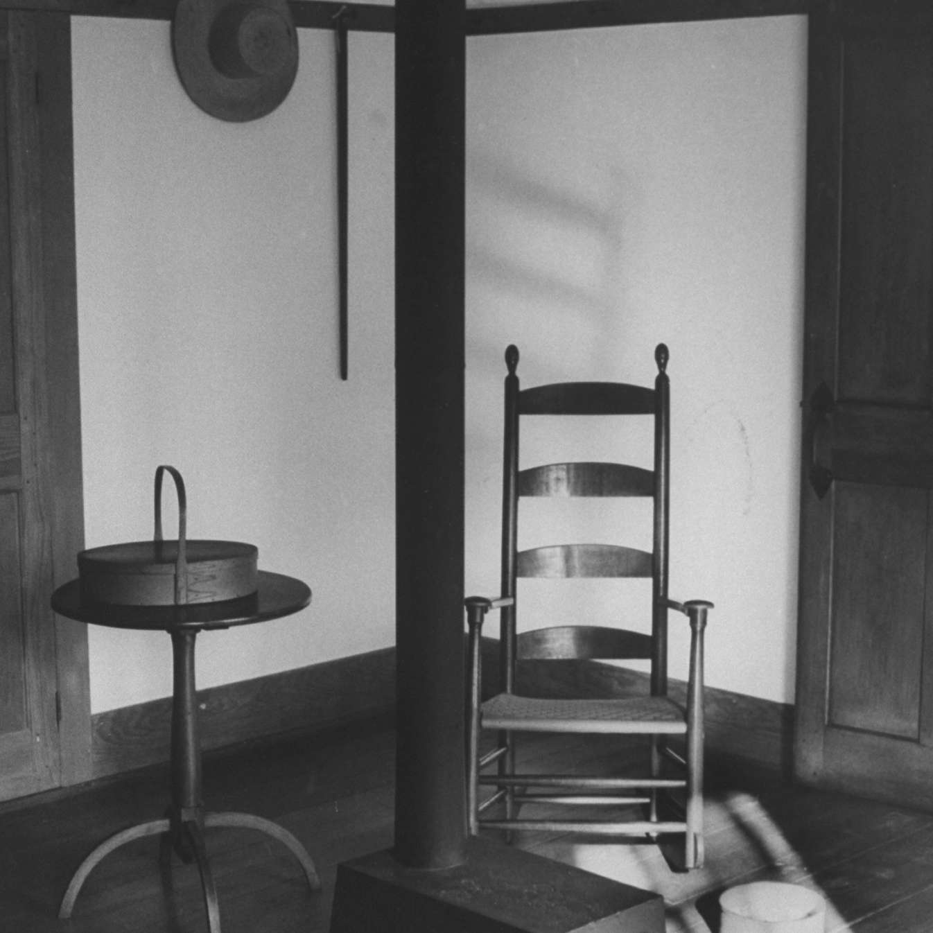 Iron woodstove w. a ladder-backed wooden