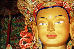 A golden statue of Maitreya in India