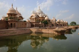 The temple of Kusum Sarovar, a historical sandstone monument, and the pool that surrounds it