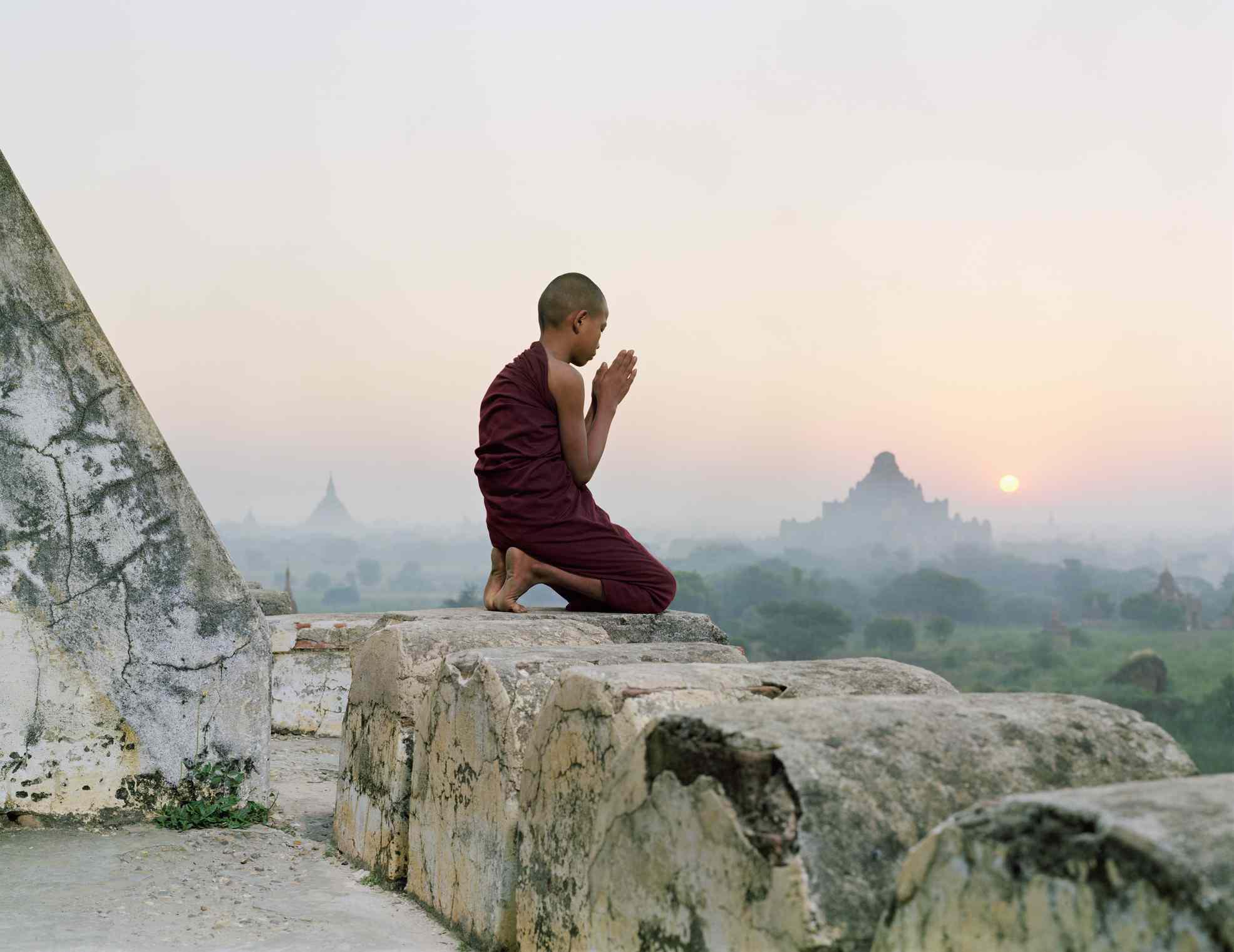 Buddhist monk praying on temple