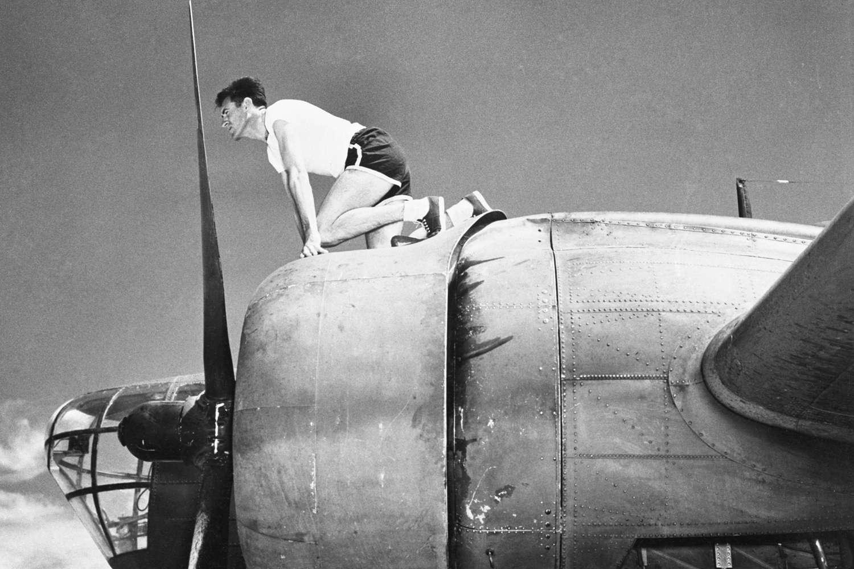 Louis Zamperini Perched on B-18 Bomber