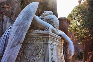 Sad angel statue in cemetery