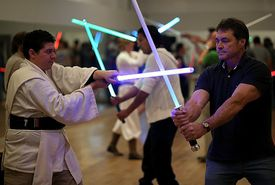 Star Wars fans train in a light-saber class
