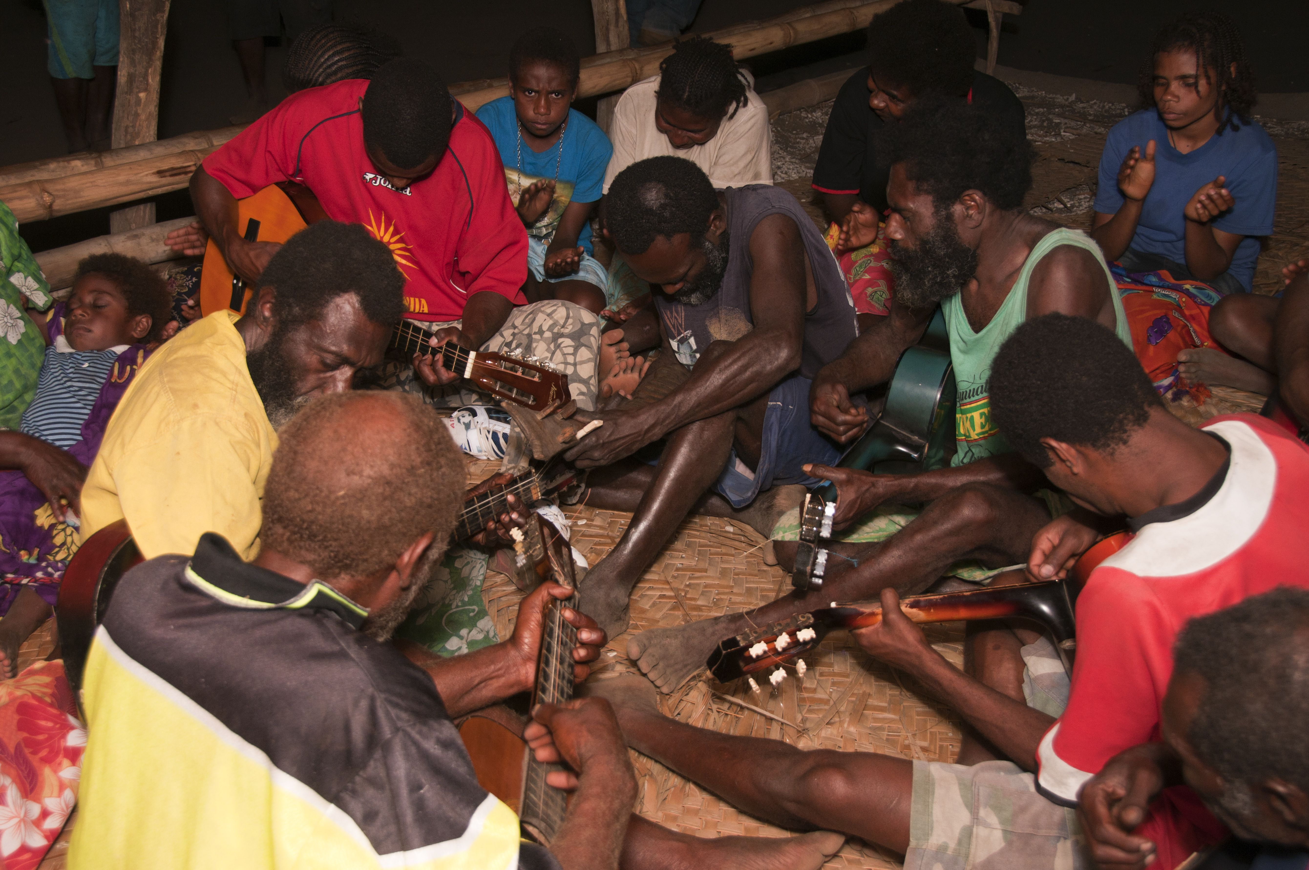 Regular Friday night singing by villagers following the John Frum cargo cult.
