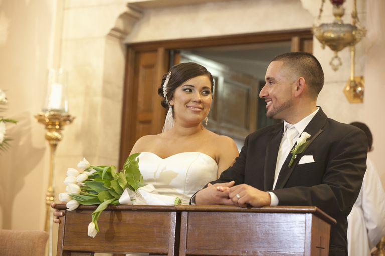 Bride and groom in Catholic wedding.