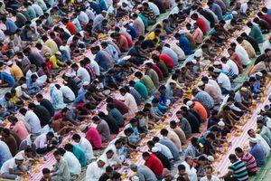 Muslim men break their fast with Iftar during the month of Ramadan, at Al Satwa bus station, Dubai.