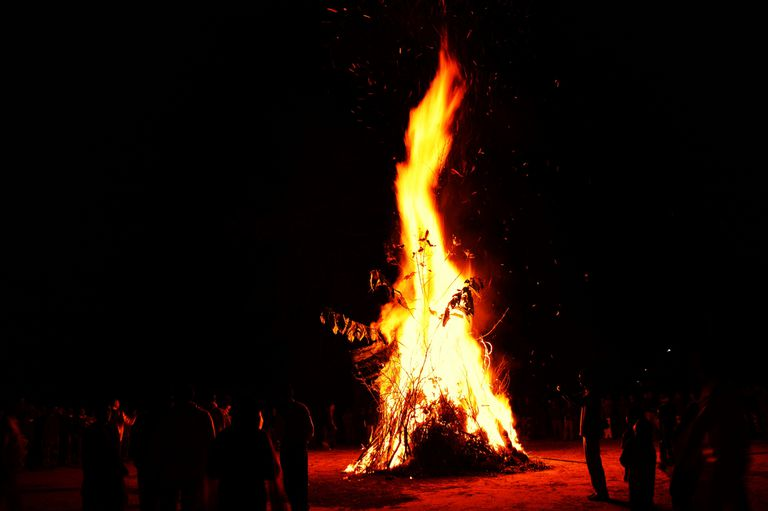 People celebrating Lohri around massive bonfire