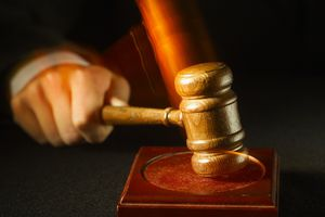 hand with judge's gavel justice