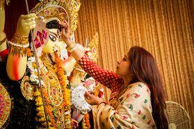 Bengali Woman Hindu Devotee Making Offering to Godess Durga