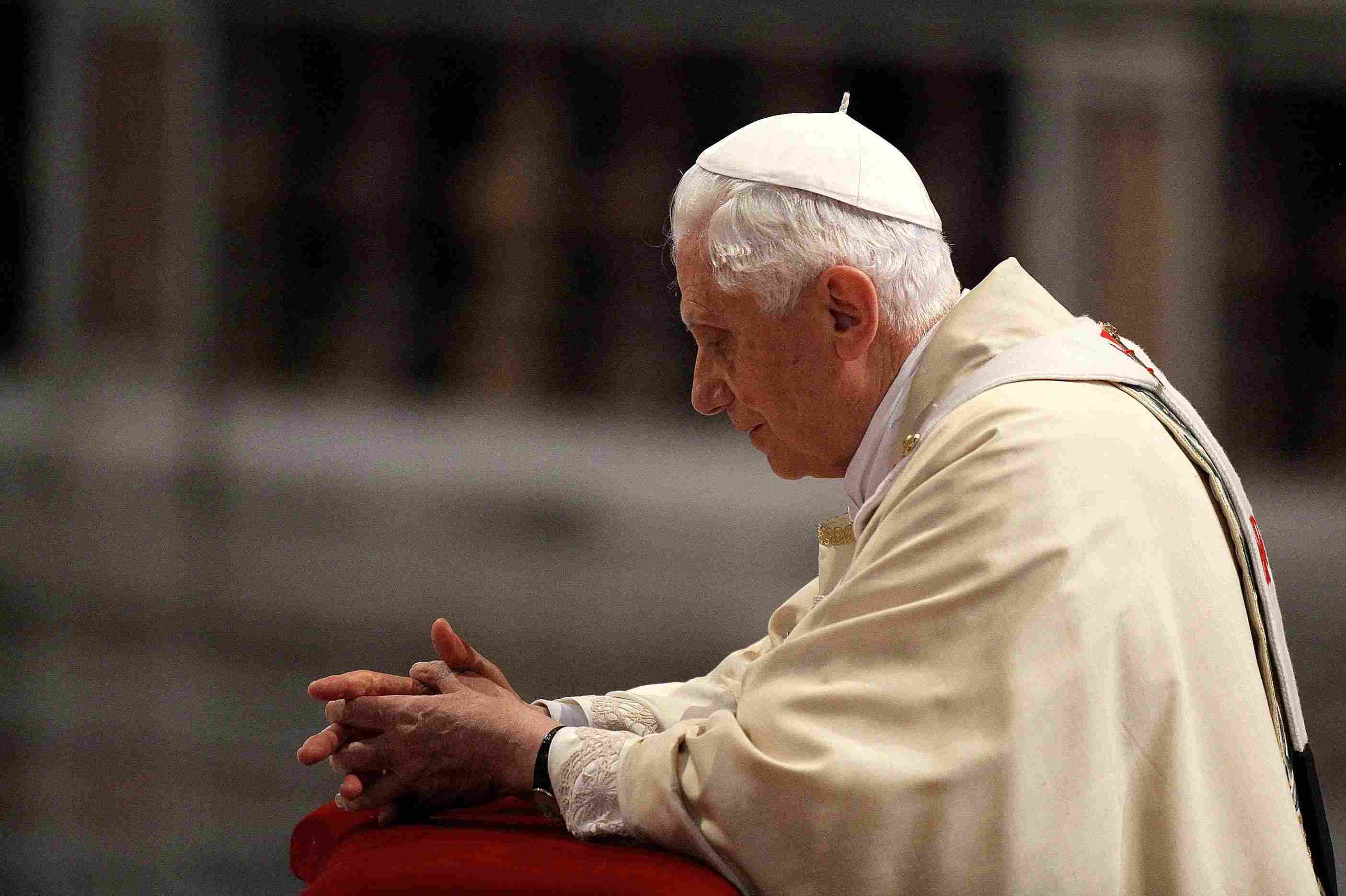 Pope Benedict prays in front of Pope John Paul II's coffin, May 1, 2011. (Vatican Pool/Getty Images)