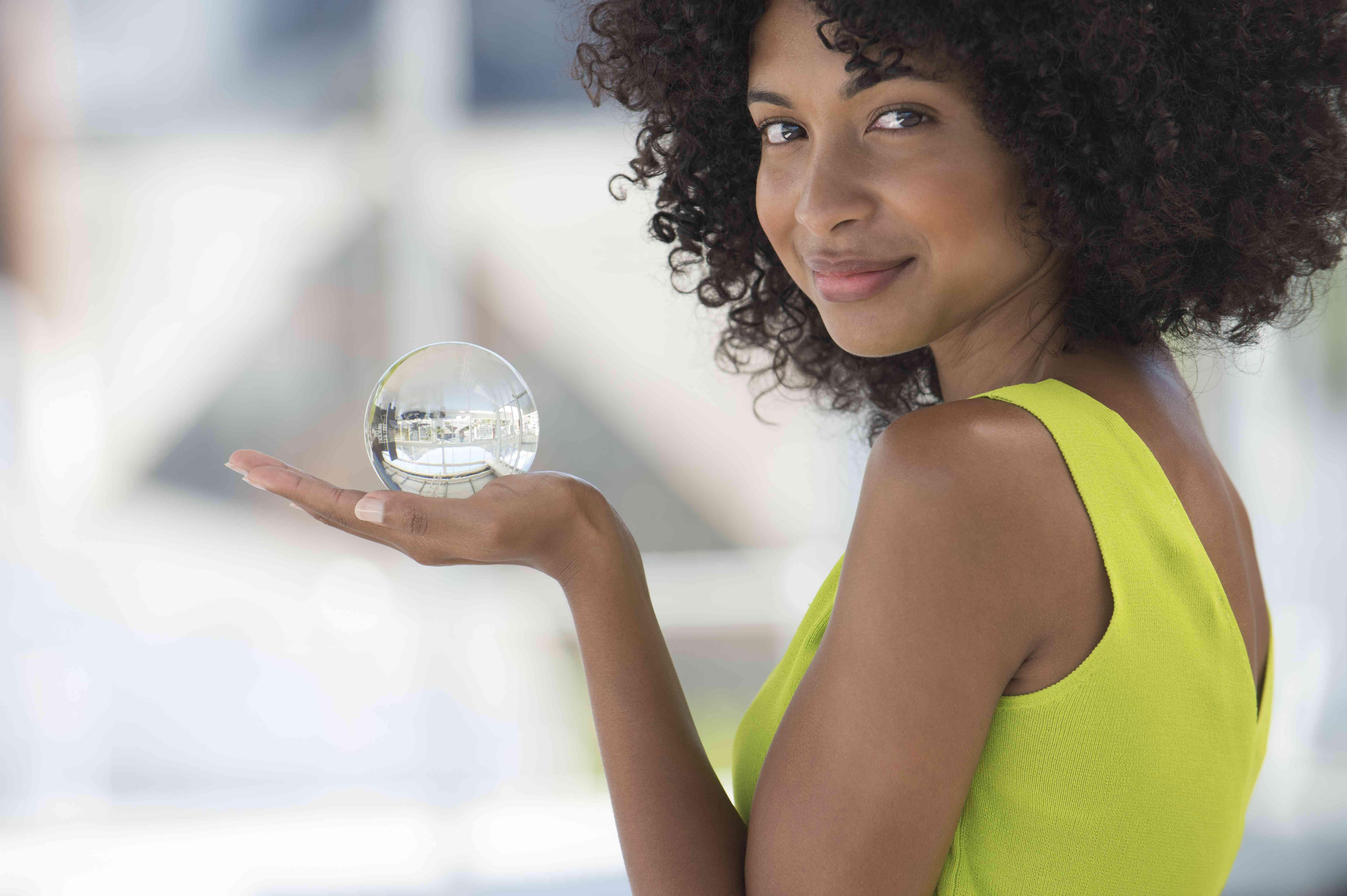 Portrait of a woman holding a crystal ball