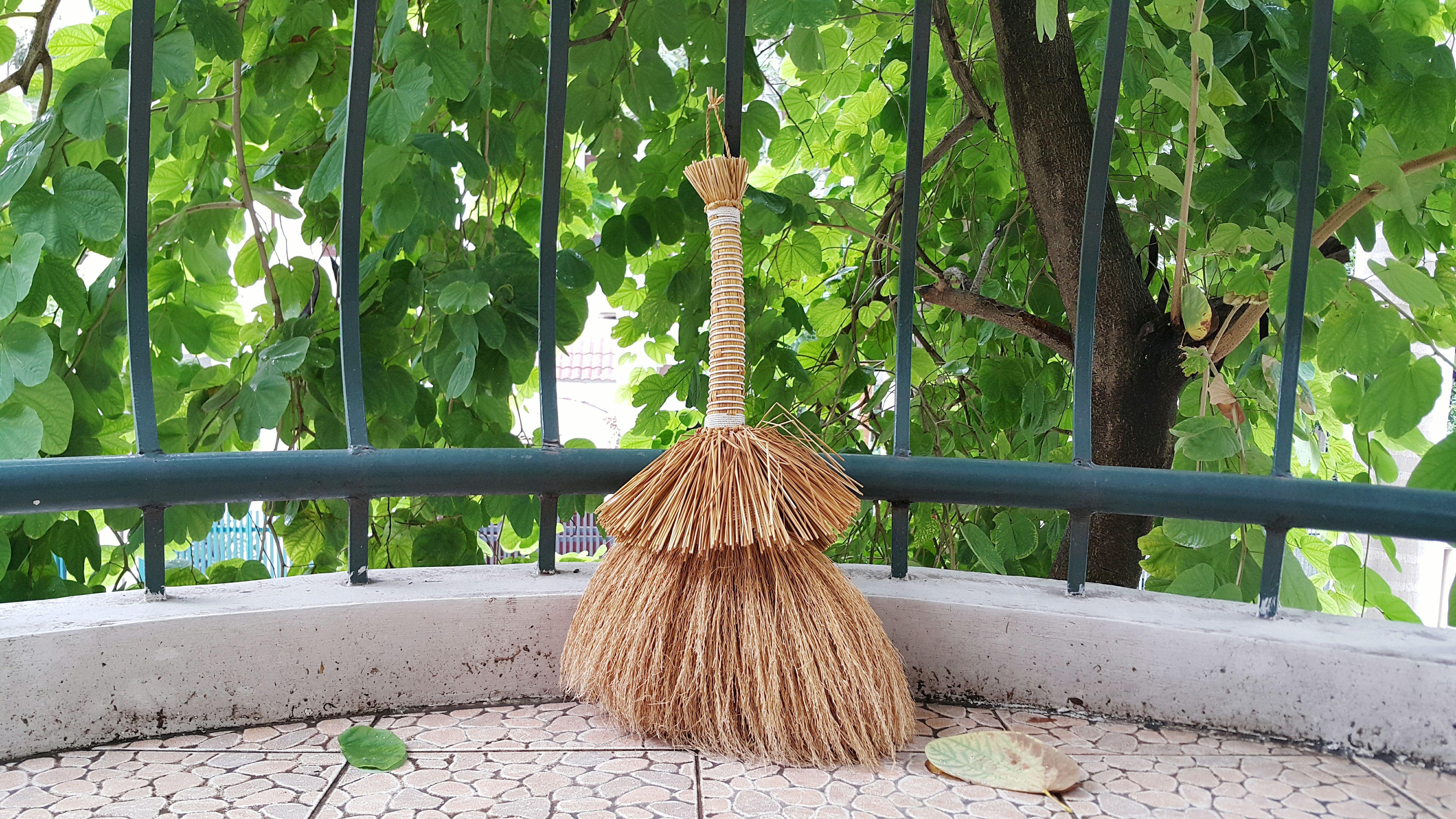Broom In Balcony Against Railing