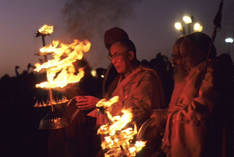 His Holiness The 14th Dalai Lama holding fire