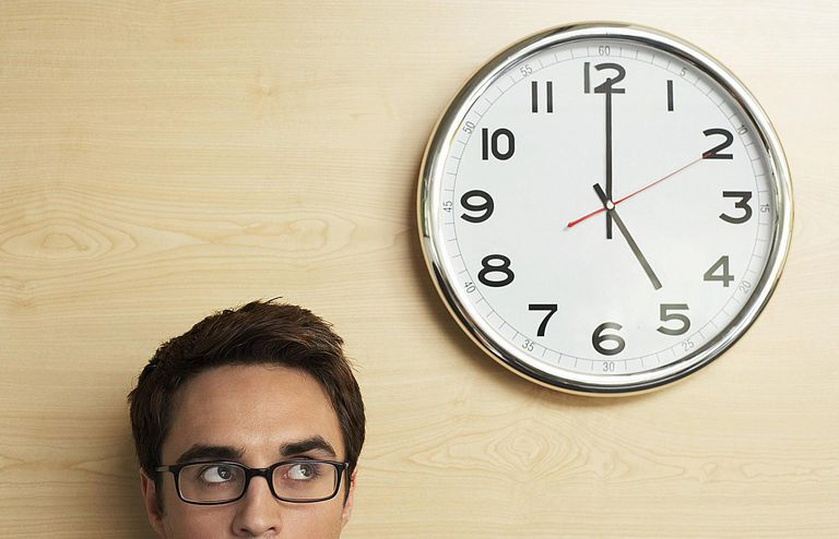 Man looking at a clock